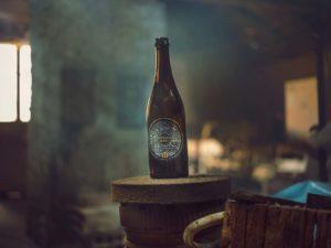 Pivní lahev Genius noci